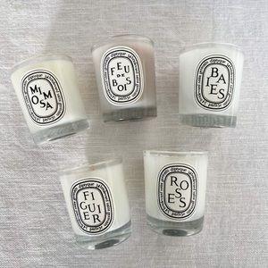 Set of 5 mini unused Diptyque candles.